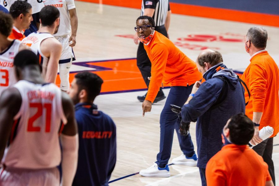 Former Illinois assistant basketball coach Chin Coleman instructs players at the game against Nebraska Feb. 25. Coleman and former assistant coach Orlando Antigua have been hired by Kentucky.