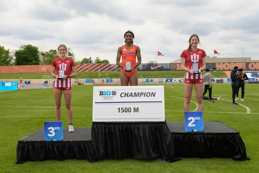 Sophomore Olivia Howell poses for a photo after winning the 1500 meter race at the Big Ten Championships. Howell has excelled during this track and field season despite COVID-19 restrictions limiting the team last year.