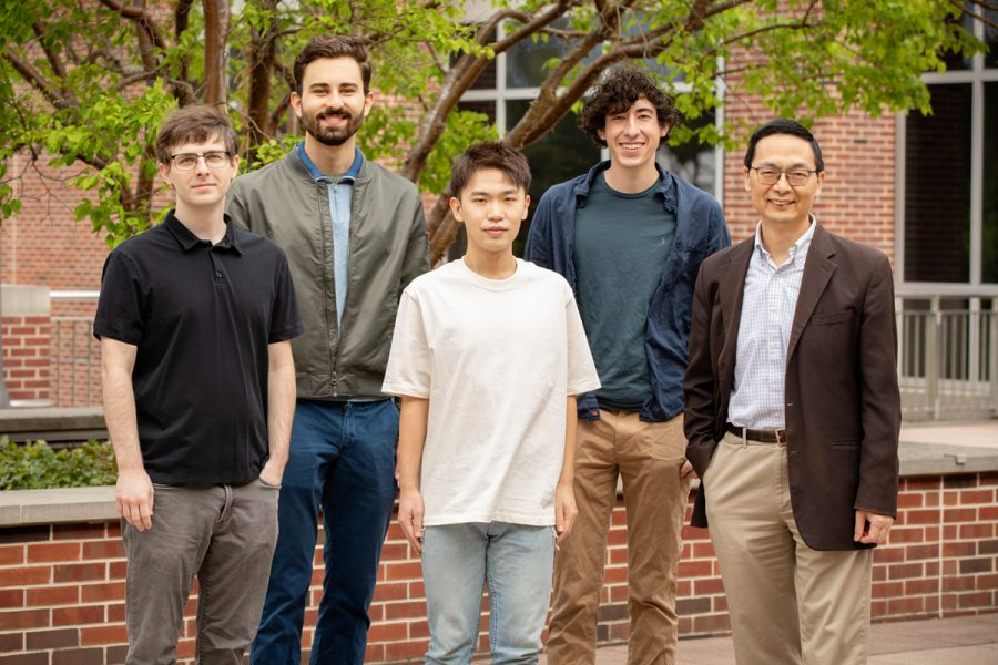 Human Zhao research group consisting of from front left, Stephan Lane, manager of the Illinois Biological Foundry for Advanced Biomanufacturing; graduate student Guanhua (Daniel) Xun; Huimin Zhao, the Steven L. Miller Chair of chemical and biomolecular engineering, and a professor of chemistry, biochemistry, biophysics, and bioengineering. In back, from left, electrical and computer engineering undergraduate student Vassily Petrov; and mechanical science and engineering undergraduate student Brandon Pepa, who recently graduated pose for a photo. The team created a portable Covid-19 testing device.