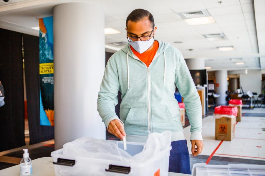 Student Anirudh Nandella deposits his completed University COVID-19 test into a receptacle at the ARC on Feb. 1. Testing at the University allowed for a safe return to campus by effectively identifying and quarantining infected individuals.