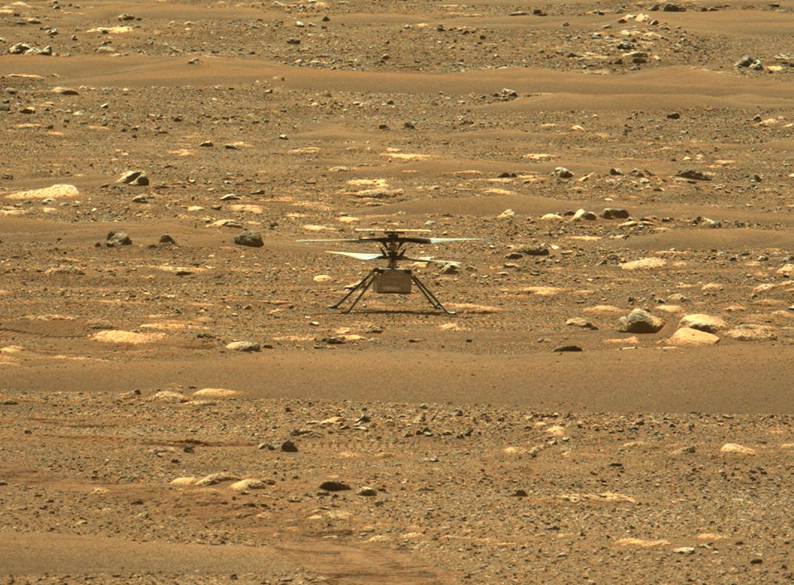 NASA's Ingenuity Mars helicopter is photographed by the Perseverance rover on Mars right after a successful high-speed spin-up test on April 16. University alumna MiMi Aung is currently overseeing the helicopter operation.