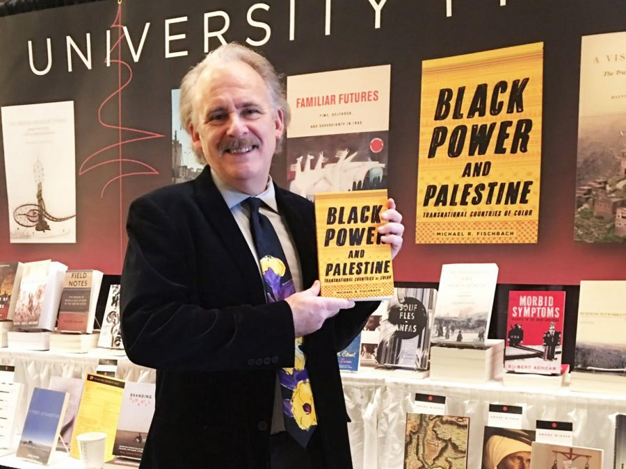 "Author Michael Fischbach poses for a photo with his book ""Black Power and Palestine"" at the Middle East Studies Association awards on Nov. 16, 2018. University RSO's Black Students for Revolution and Students for Justice in Palestine spoke with Fischbach about intersectionality of Black and Palestinian struggles."