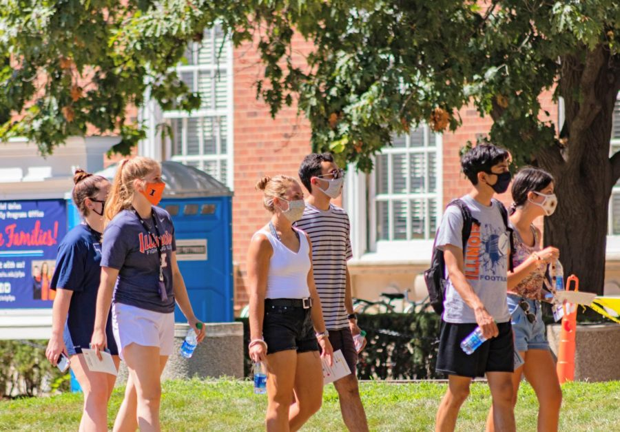 Students walk outside the Illini Union on Aug. 21. Columnist Noah Nelson encourages Illini to power through finals week.