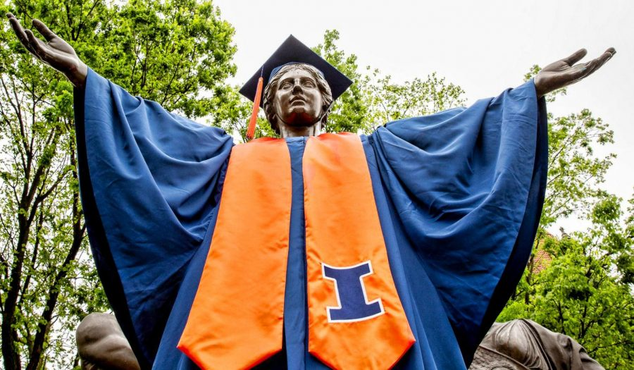Alma Mater stands tall at the corner of Wright and Green streets dressed in a commencement robe. University students remind each other that making mistakes is part of your educational journey.