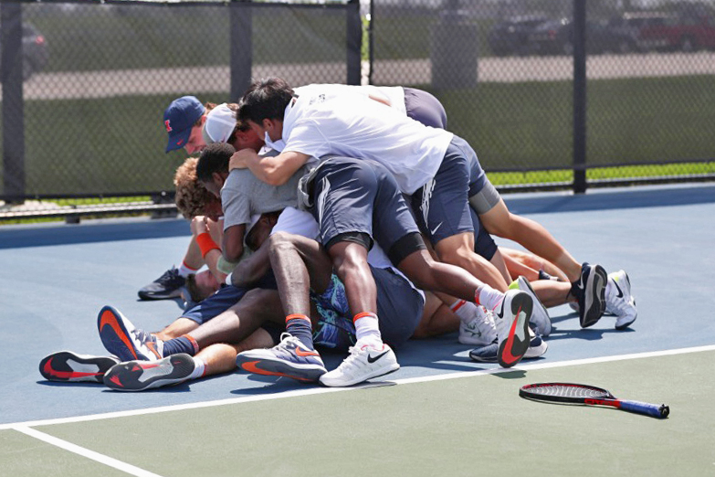 Communications The Illinois men's tennis team celebrates on the court after winning the Big Ten tournament Sunday.