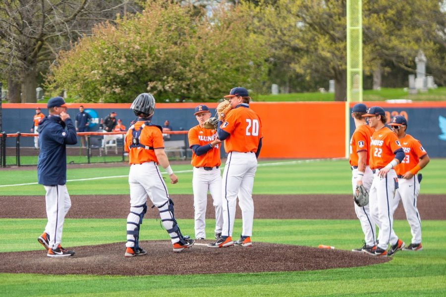 The Illinois baseball team meets on the pitcher's mound to discuss strategy against Purdue April 18. The Illini are currently struggling with pitching.