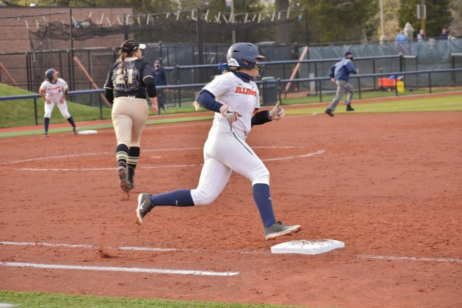 Sophomore Gabi Robles runs to first base after a hit against Purdue on April 16. Robles tries to use obstacles she faces as motivation on the field during her games.