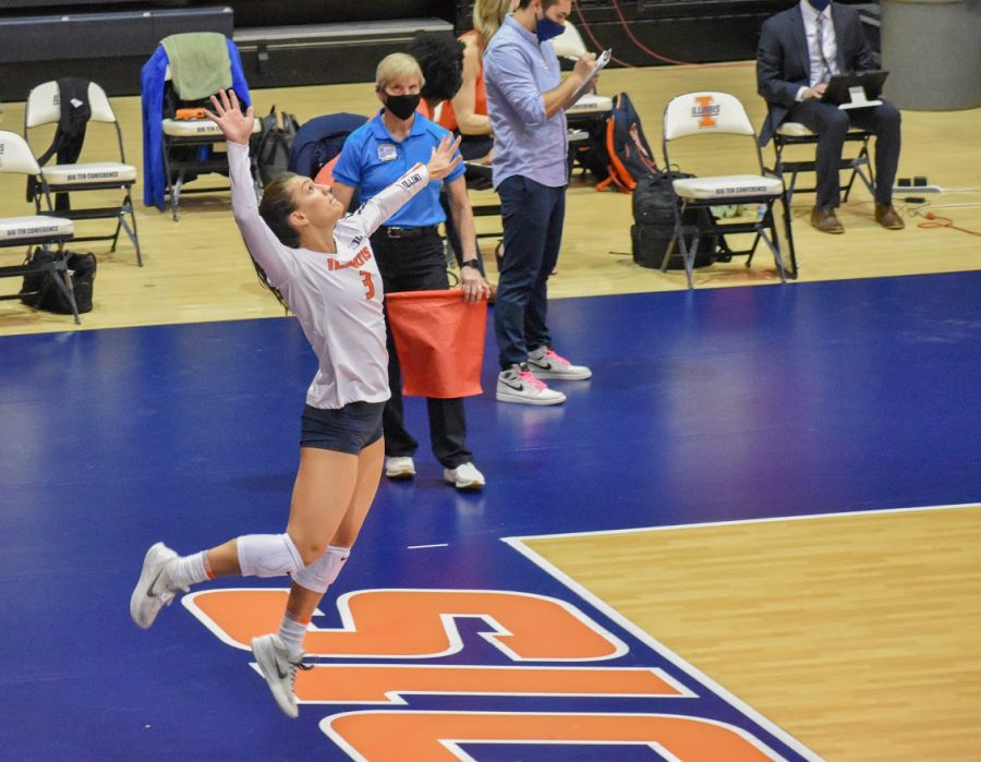 Junior Taylor Kuper sets-up the serve against Indiana on March 27. Although Kuper is a force to be messed with now, she did not have the easiest time getting to this position.