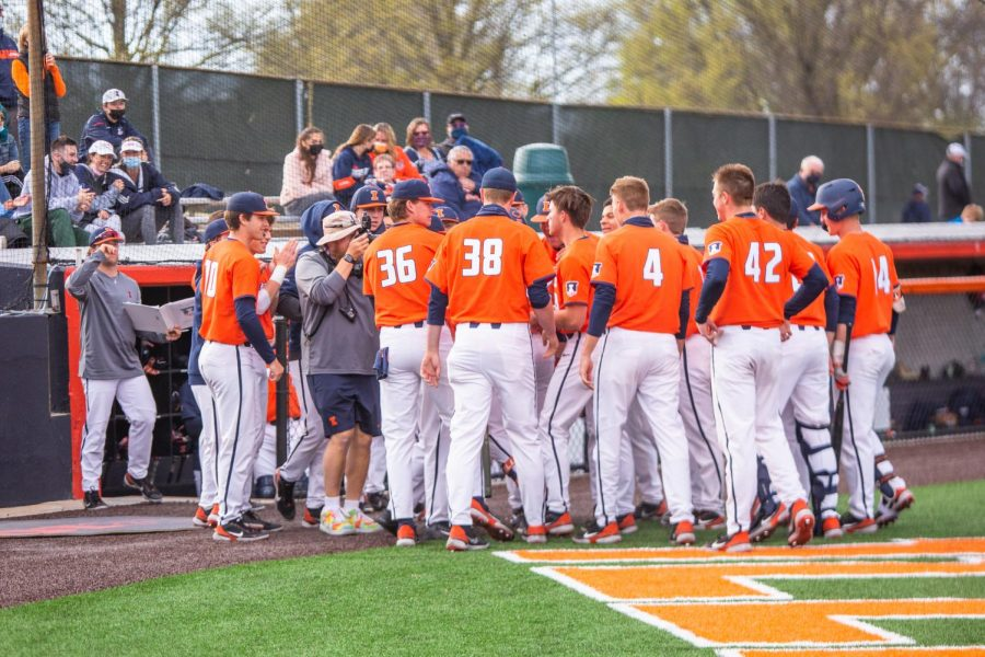 The Illinois men's baseball team exits the dugout to celebrate a teammates home run during the game against Purdue April 18. Illinois will head to Evanston for a four-game series against Michigan this weekend in two double headers.