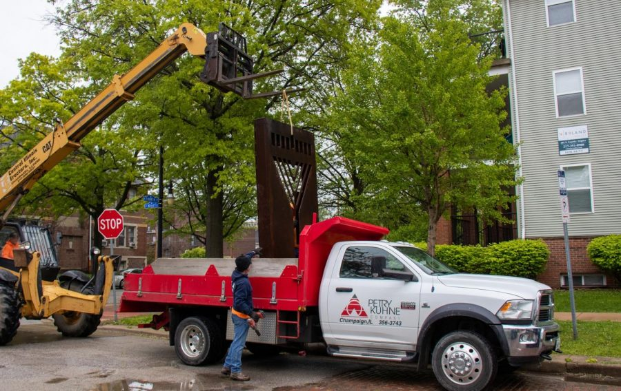 The monument was put into a truck for people to follow behind to the new Chabad place.