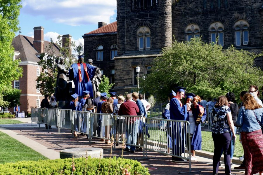 Illinois graduates line up in front of Alma Mater in commencement attire for a photo on Thursday. Students who graduated this past week have overcome one of the hardest years in all of their academic endeavors.