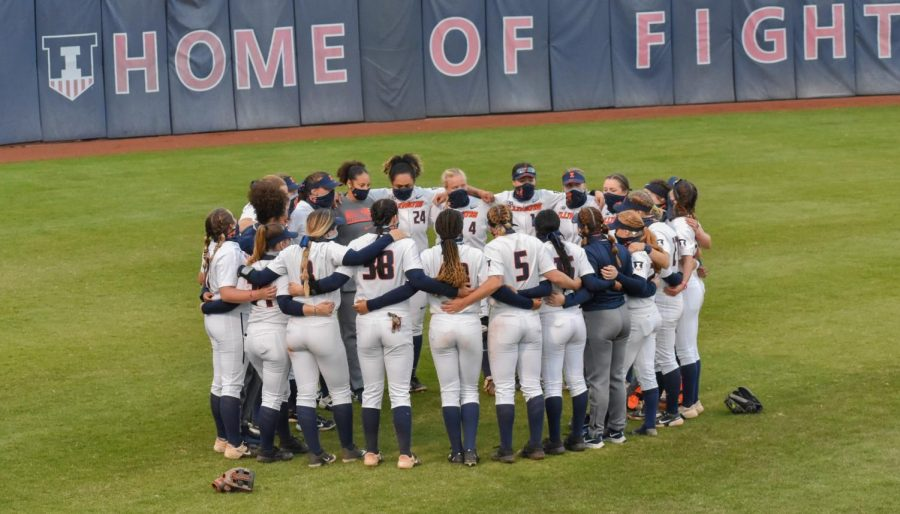 The Illini softball team huddles around after their game against Purdue on April 16. The team's regular season has now come to an end.