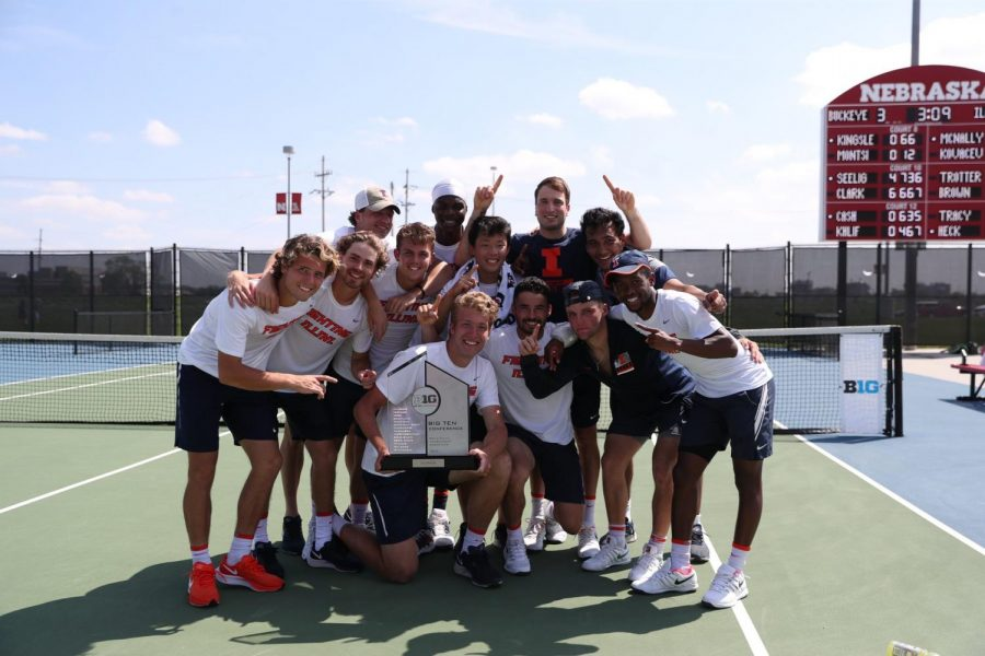 The Illinois men's tennis team poses with the Big Ten Championship trophy after winning the tournament on Sunday. The title is the program's first since 2015.