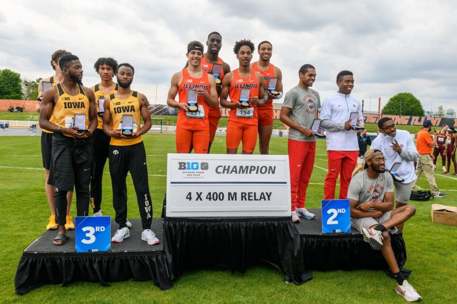 Robert+Williams%2C+Jason+Thormo%2C+Aman+Thornton%2C+and+Kashief+King+stand+on+a+podium+with+their+4x400+men%27s+relay+awards+on+Sunday+at+Demirjian+Park.+The+Illinois+men%27s+and+women%27s+track+and+field+teams+set+many+personal+records+at+the+Big+Ten+Outdoor+Championships.