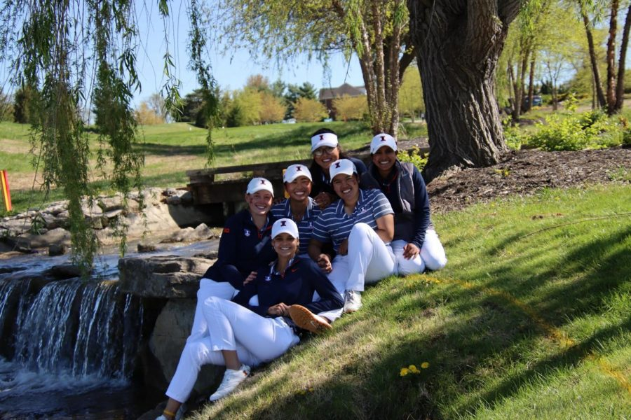 The women's golf team sits together as they wait to play their Big Ten Tournament. The team is now preparing to play the NCAA Tournament this Monday.