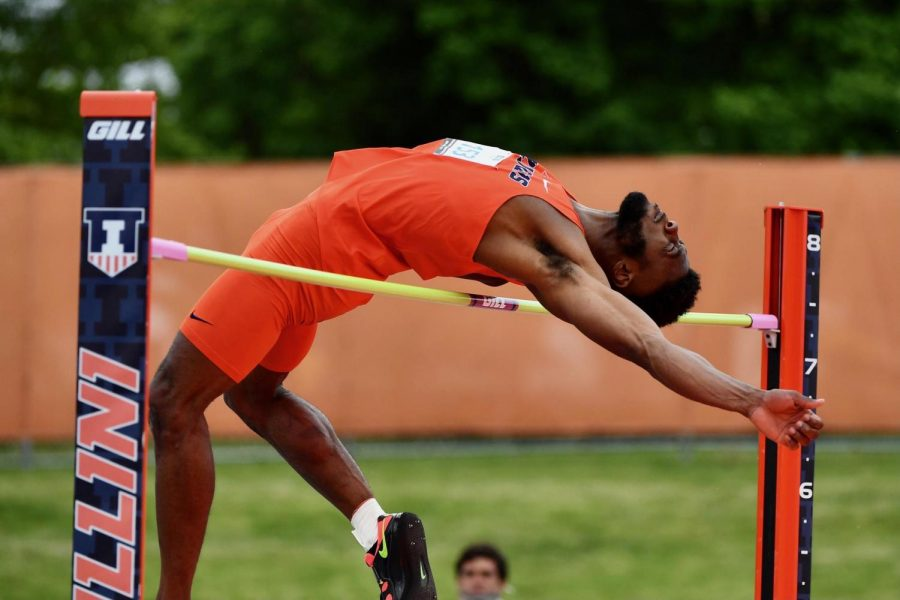Graduate student Jonathan Wells makes a backwards leap over the high jump on Saturday at the Big Ten Outdoor Championships. The Illinois track and field team hopes to keep their pace amongst other schools in preparation for the NCAA West Prelims.