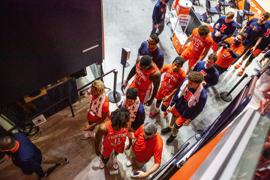 The Illinois men's basketball team exits the court after the game against Iowa at State Farm Center Jan. 29. As the team just lost two assistants coaches to Kentucky, Chester Frazier is hired to take their place.