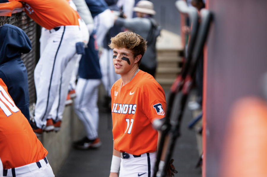 Justin Janas walks through the dugout during the game against Purdue April 18. Five players from the Illini baseball team will made the All-Big Ten team this season.