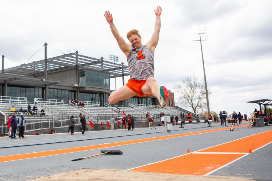 Junior Connor Artman leaps into the air during the long jump event at the Fighting Illini Big Ten Relays April 23. The Illinois track and field team will host the Big Ten Outdoor Championships this Friday, Saturday and Sunday at Demirjian Park.