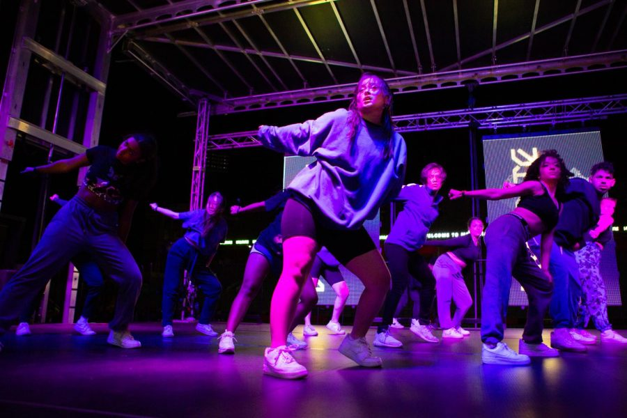 Members of the group Dance2XS UIUC performs a move onstage at the URBANITE Dance Showcase May 1.
