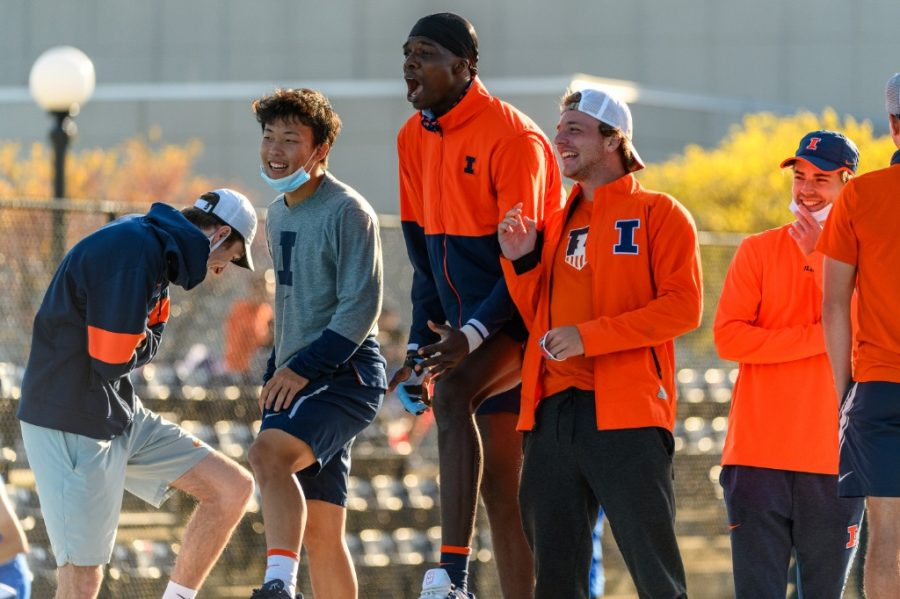The Illinois tennis team cheers on teammates from the bench during their game May 7 against Depaul. The teams bench energy continues to hype up every player on the team.