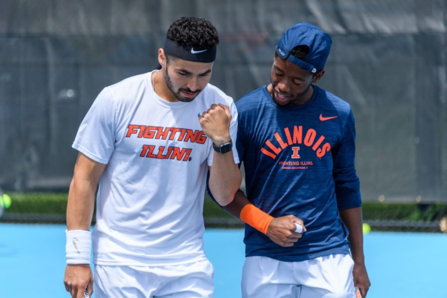 Senior Noe Khlif and sophomore Siphosothando Montsi celebrate after gaining a point in a match on May 8 against Notre Dame. In Florida, the team had a lot of support from Illinois fans bu fell to top-seeded Florida in the Round of 16.