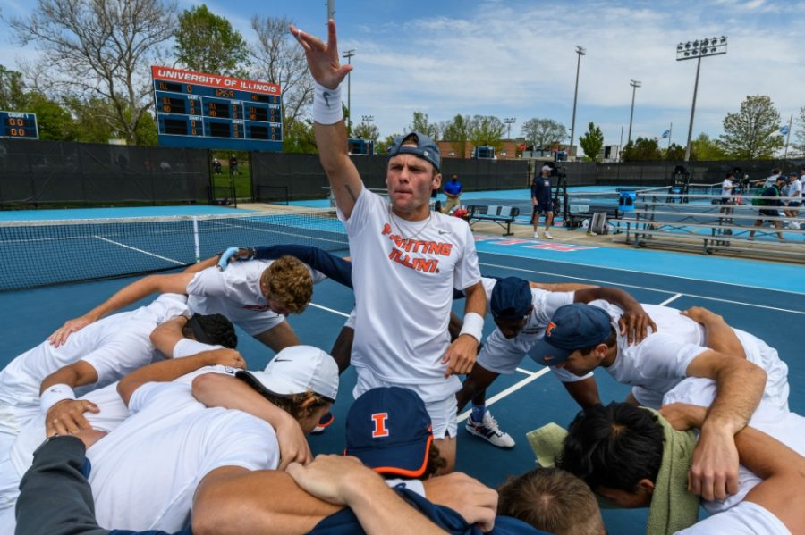 Senior Zeke Clark stands in the middle of a team circle May 8 against Norte Dame. Over a long season, the team has accomplished a lot and proven to be strong together.