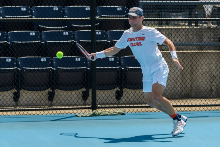 Senior Zeke Clark swings at the tennis ball during a match against Norte Dame May 8. Senior Clark and Sophmore Montsi made their first time appearance at the NCAA Singles Tournament.