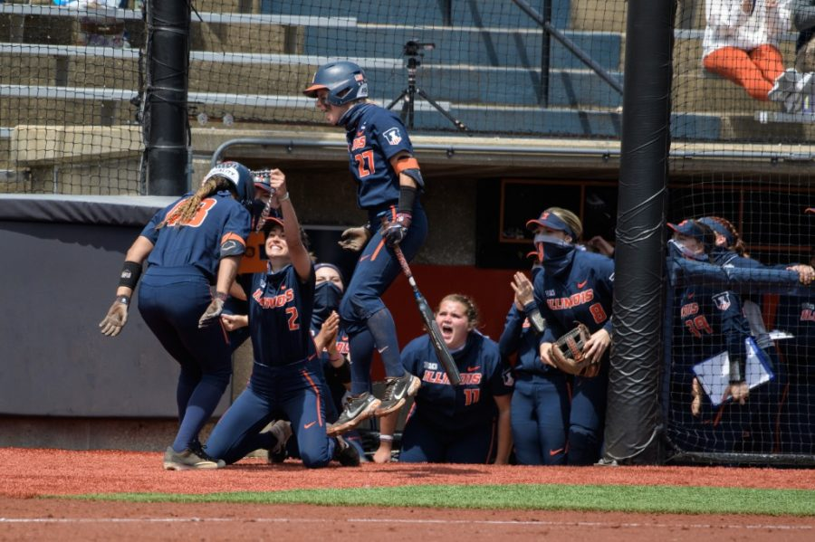Illinois softball players celebrate Jaelyn Vickery during the game against Ohio State May 8. The team reflects on a successful season with multiple accolades amidst the pandemic.