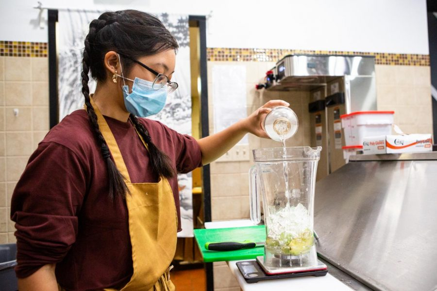 Freshman in Engineering Maia DeGuzman works behind the counter at Tenko Tea on March 9. University students can save money in multiple ways by following these helpful tips.