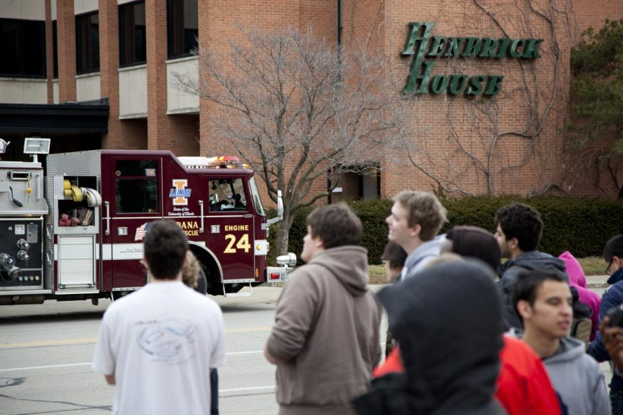 Students watch as the Urbana Fire Department responds to a fire at Hendrick House on Mar. 2, 2012. The Hendrick House experienced a boiler explosion on Monday night.