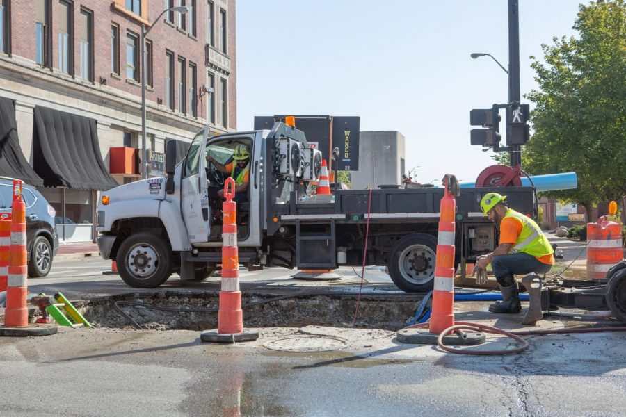 Construction workers repair a pipe in October 2020. The bridge on Springfield is closed and is set to be closed for months while it undergoes repairs.
