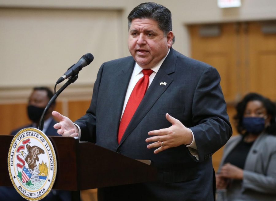Governor J.B. Pritzker answers questions at a news conference on March 26, 2021. Illinois lawmakers approved a budget that will maintain funding for higher education.