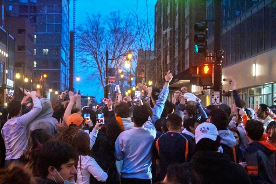 Students rush to the streets after the Illinois Basketball team won the Big Ten Tournament on March 14. The energy at Illinois creates a united culture unlike any other campus.