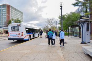 University students board a CUMTD bus next to Florida Avenue Residence Hall on April, 11. Champaign-Urbana Mass Transit District continues their expansion project at Illinois Terminal.