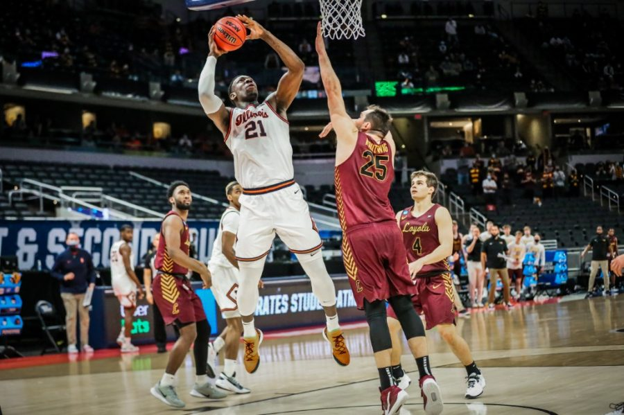 Junior Kofi Cockburn jumps to shoot a basket against a player from Loyola Chicago during the second round of the NCAA Tournament March 21. Illinois needs a top performing athlete to continue the basketball programs relevance.