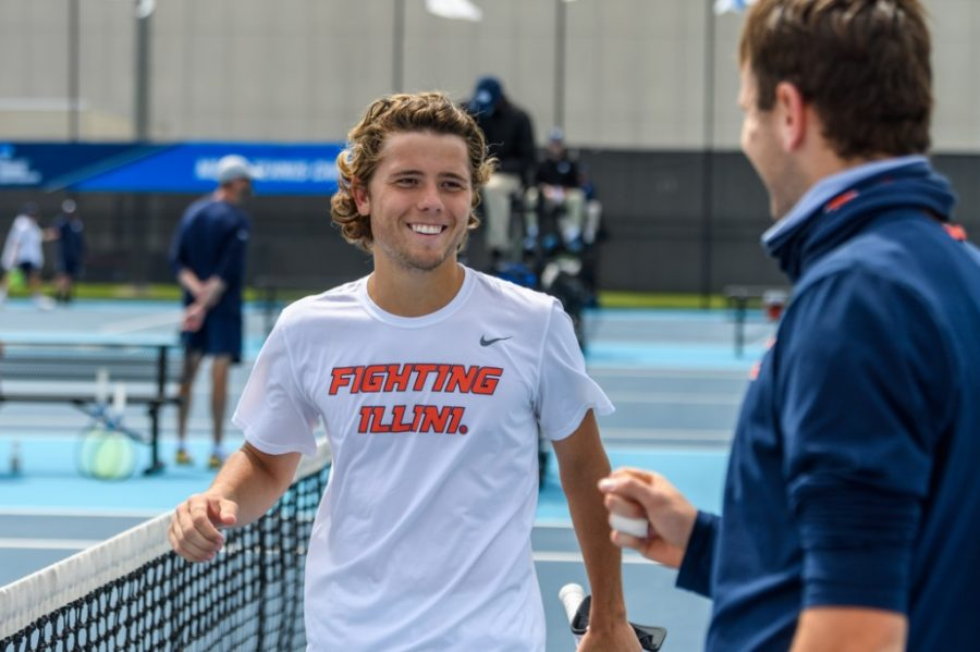 Aleks Kovacevic smiles after winning a singles match against Notre Dame May 8. Kovacevic reflects on his past five years at Illinois.