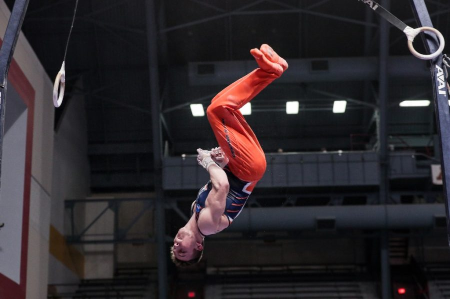 Junior Michael Fletcher dismounts from the still rings at the NCAA Championships on April 17.  Fletcher, along with Illinois alumni Michael Paradise and Alex Diab, will be competing in Fort Worth, Texas, at the U.S. Gymnastics Championships.