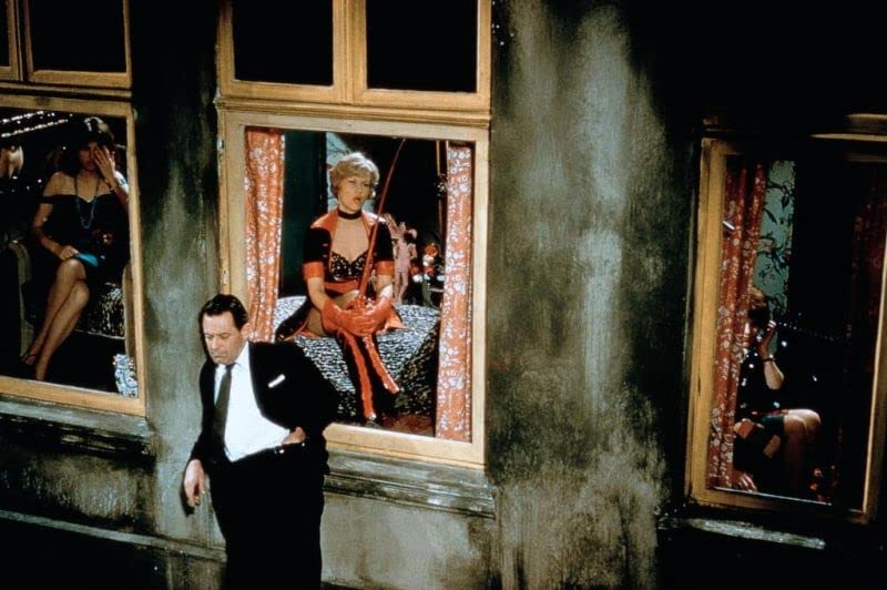 William Holden and Ingrid van Bergen acting in the movie The Counterfeit Traitor. The movie came out in 1962.
