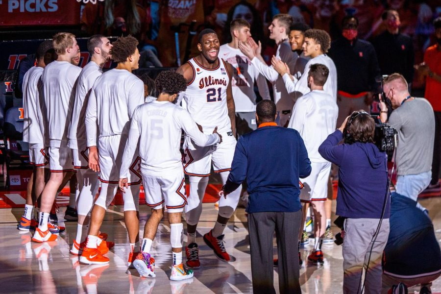 Kofi Cockburn is introduced during pregame lineup announcements against Wisconsin on Feb. 6. With Cockburns return, Illini fans should hope their team can make it into the second weekend of the NCAA tournament for the first time since 2005, Simberg writes.