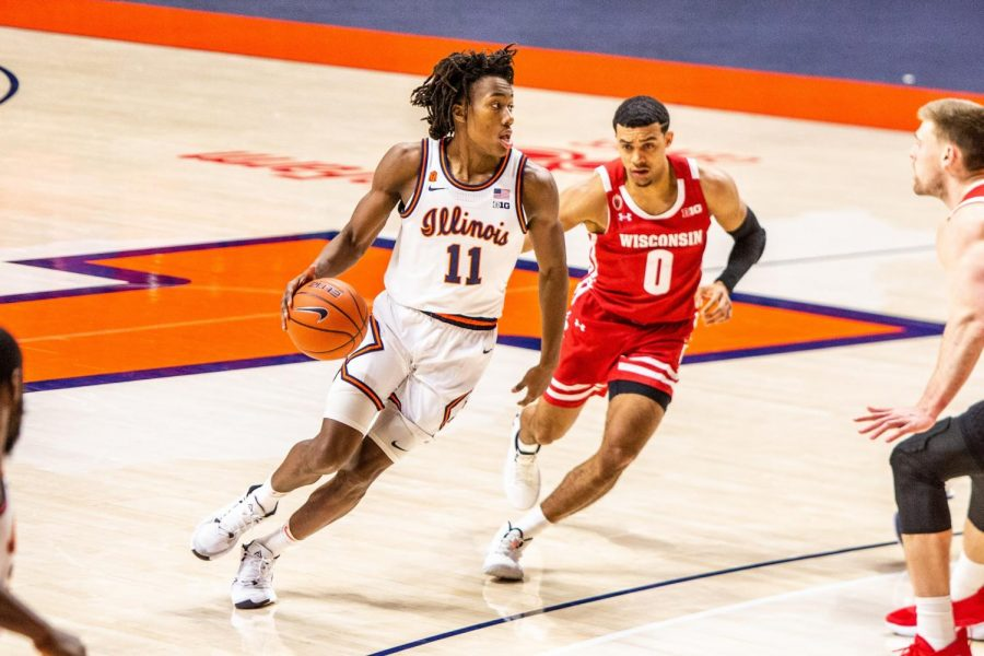 Ayo+Dosunmu+looks+for+teammates+during+the+game+against+Wisconsin+at+State+Farm+Center+on+Feb.+6.+After+being+selected+by+the+Chicago+Bulls%2C+Dosunmu+will+join+a+team+with+depth+at+the+guard+position.
