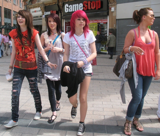 A group of teens walk outside of a GameStop in the early 2000s. Columnist Jane Knight proposes to bring cringe back to combat unrealistic beauty standards.