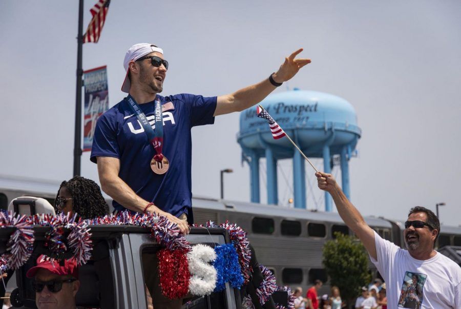 David Kendziera rides in a car during a fourth of July celebration in Mount Prospect. David Kendziera will be competing in the 400-meter hurdles for Team USA in the Tokyo Olympics.