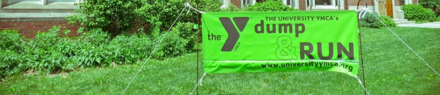 A sign set-up in front of the YMCA shows people the Dump & Run is open. The Dump & Run will be take place from Aug. 18 to Aug. 19.