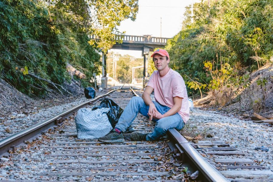 Daniel Toben sits next to the garbage he had picked up. Daniel Toben shows how little things such as picking up trash can make a huge impact.