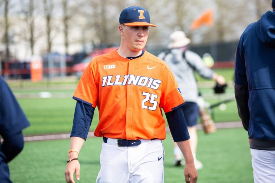 Illinois pitcher Nathan Lavender stands near the dugout prior to the game against Purdue on April 18. Lavender and teammate Andrew Hoffmann were selected in the 2021 MLB Draft.