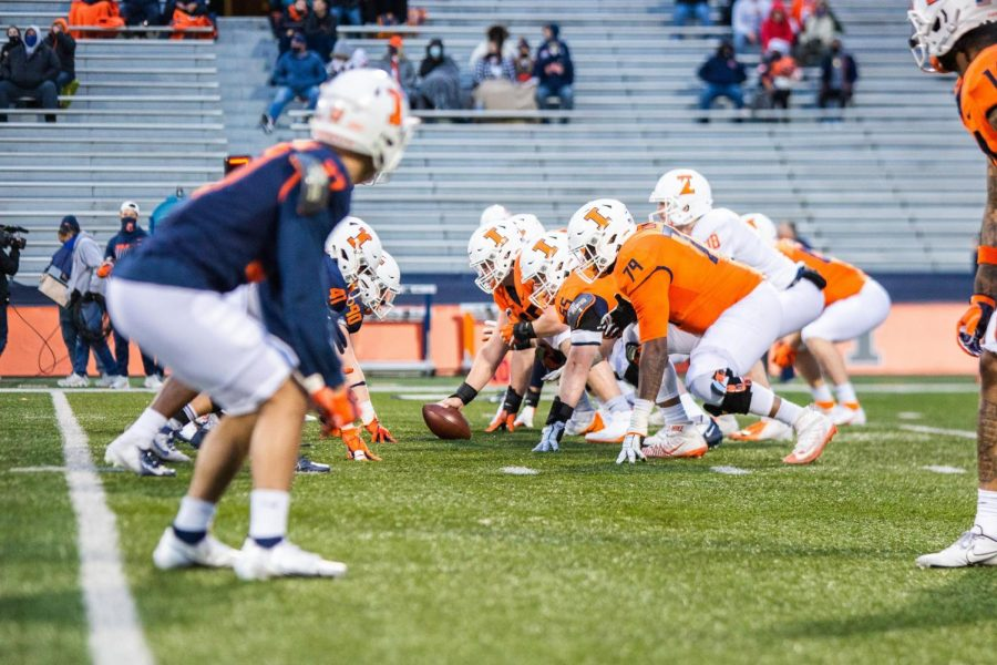 The+offensive+line+waits+to+snap+the+ball+during+the+Orange+and+Blue+game+on+April+19.+Head+coach+Bret+Bielema+and+offensive+linemen+Vederian+Lowe+and+Doug+Kramer+talked+about+their+hopes+for+the+offense+during+Big+Ten+Media+Days.