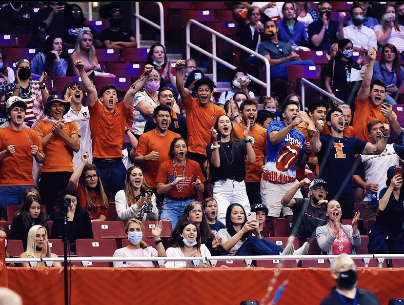 Members of the Illinois mens gymnastics team cheer for coach and former teammate Alex Diab at the U.S. Olympic Team Trials. Diab will be an alternate for Team USA and will travel with the team to Tokyo.