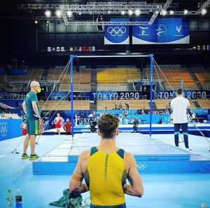 Tyson Bull prepares to perform on horizontal bar at the Tokyo Olympics. Bull advanced to the finals of the event.
