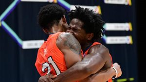 Teammates from the House of 'Paign hug after taking down the number one seed July 9, 2020. Several alumni from Illinois will be coming back to play for House of 'Paign.